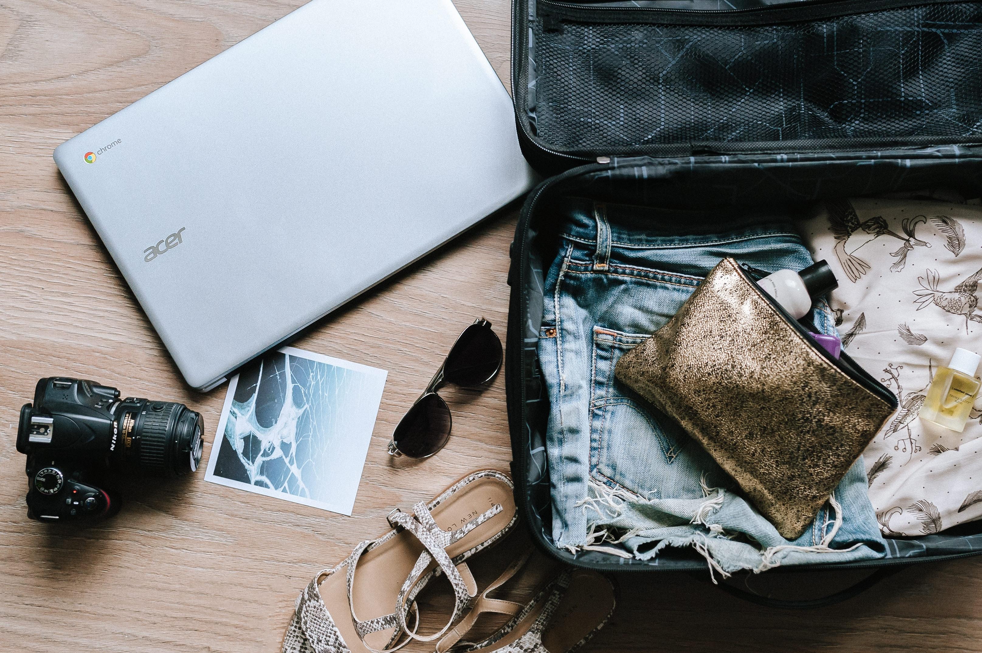 Suitcase with laptop, camera and makeup bag